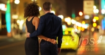 Rear view of romantic couple looking at city nightlights