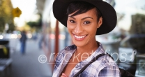 African American woman smiling on busy city street