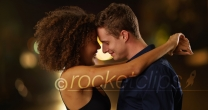 Close up portrait of couple holding each other outdoors