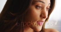 Close up of beautiful Latina female looking off camera with sad expression